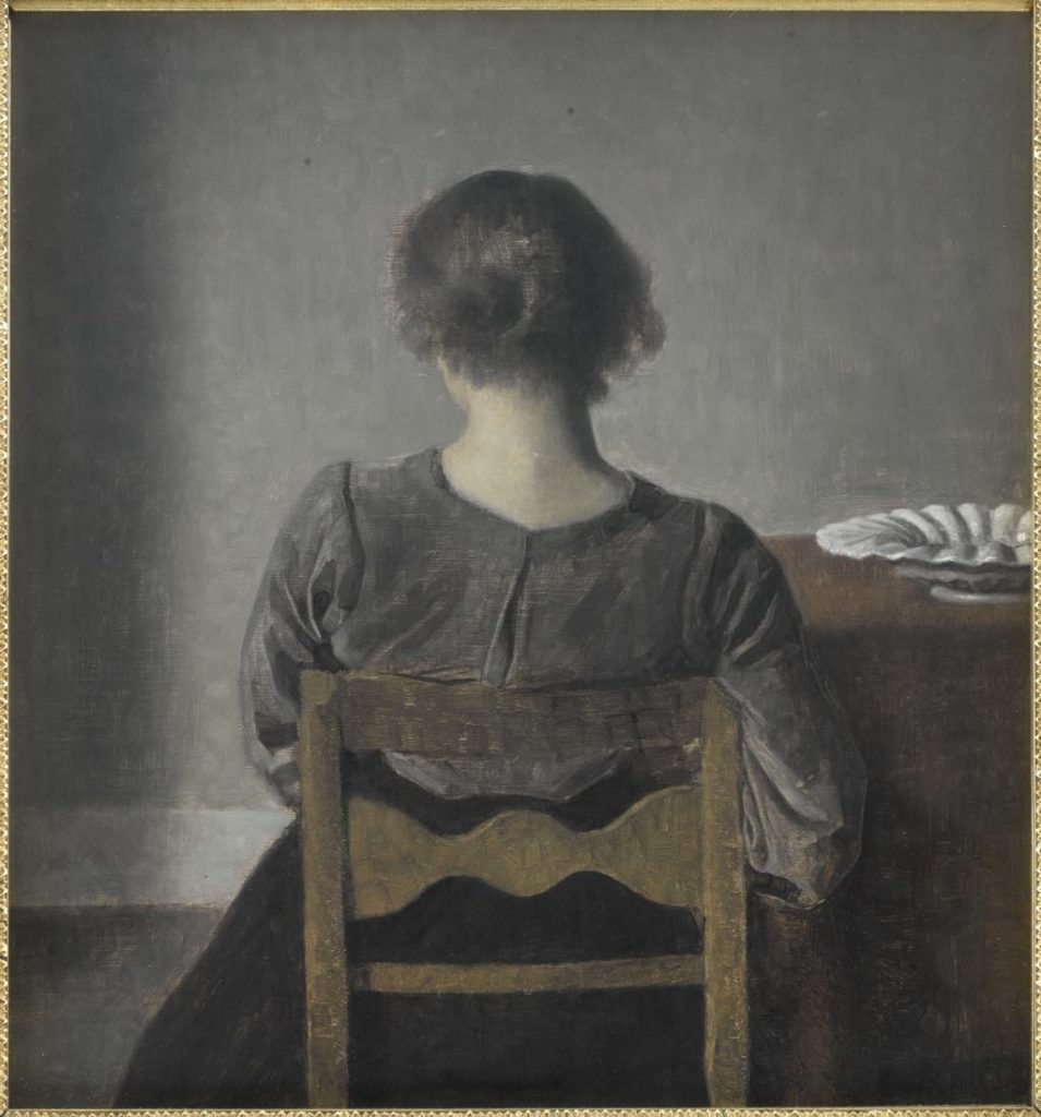 "Hammershøi ""Hvile (Rest)"" (1905). One of the rare figures in a Hammershøi painting who looks relaxed, as she leans her weight against the back of the chair. Photo © RMN-Grand Palais (Musée d'Orsay)/René-Gabriel Ojéda"