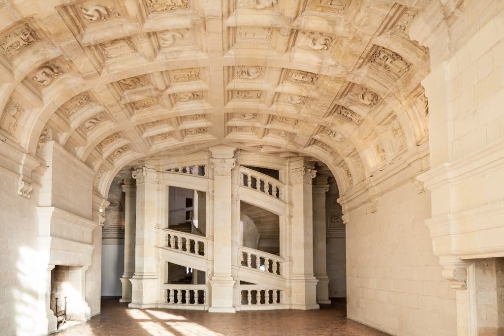 The double-spiral staircase and coffered ceiling in the Château de Chambord.
