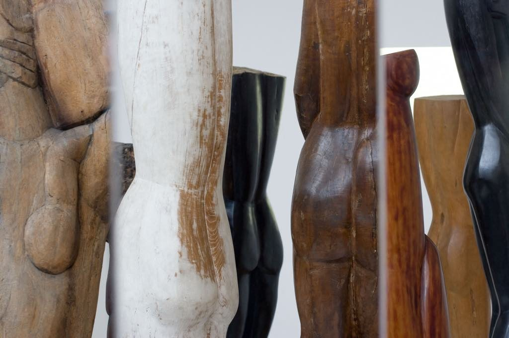 "A forest of Ossip Zadkine's wooden statues reflected in a piece by artists Angela Detanico and Rafael Lain, ""La Fleur Inverse."" © ADAGP Paris, 2019. Photo © E. Emo /Musée Zadkine/Roger-Viollet"