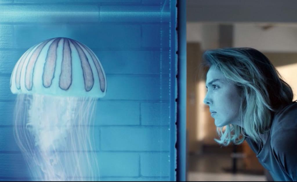 Christa Novak (Garance Marillier) studies a jellyfish, the source of mankind's immortality in Ad Vitam.