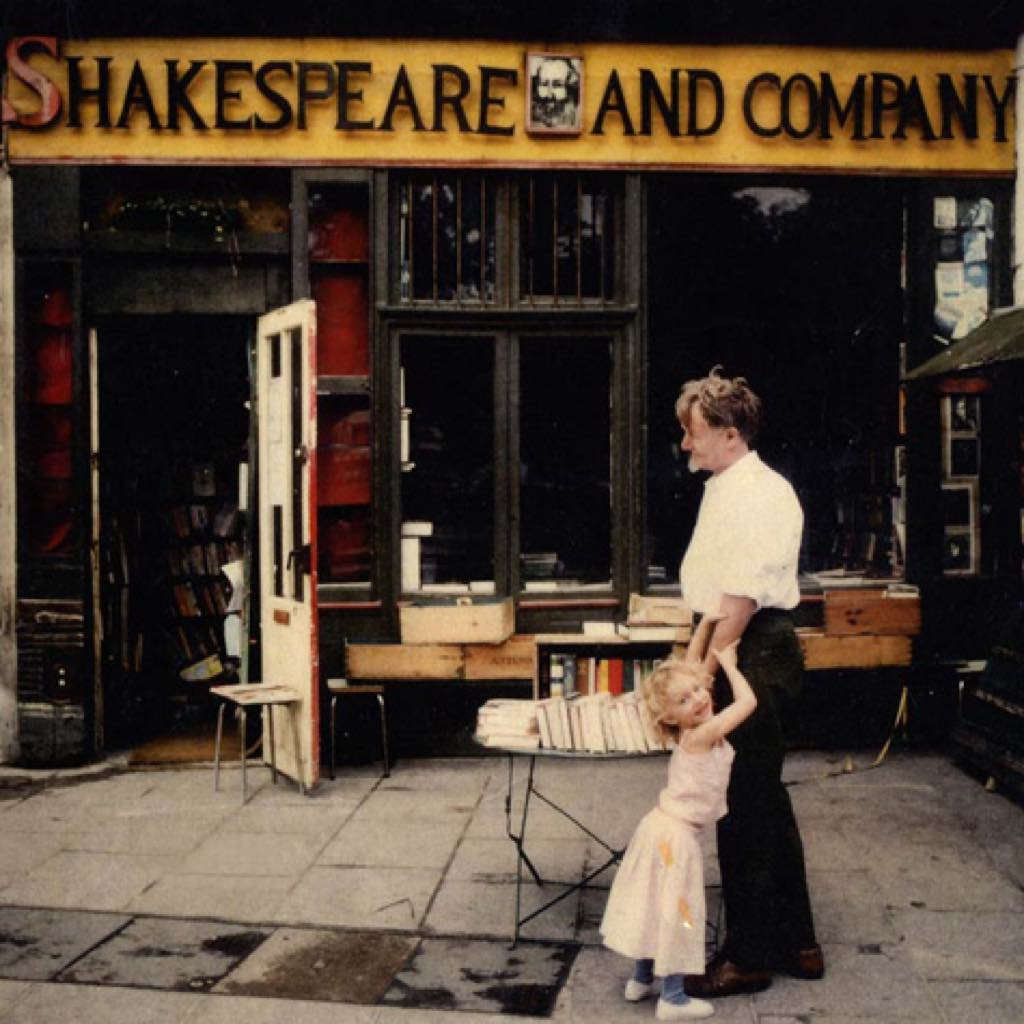 George Whitman (1913 – 2011) in front of his bookstore, Shakespeare and Company, with his daughter Sylvia, who now runs the shop.