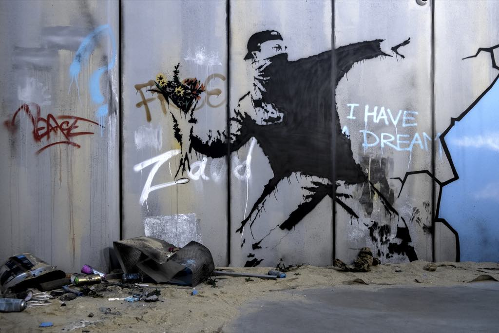 "A recreation of Banksy's ""Love Is in the Air (Flower Thrower)"" in a Paris exhibition."