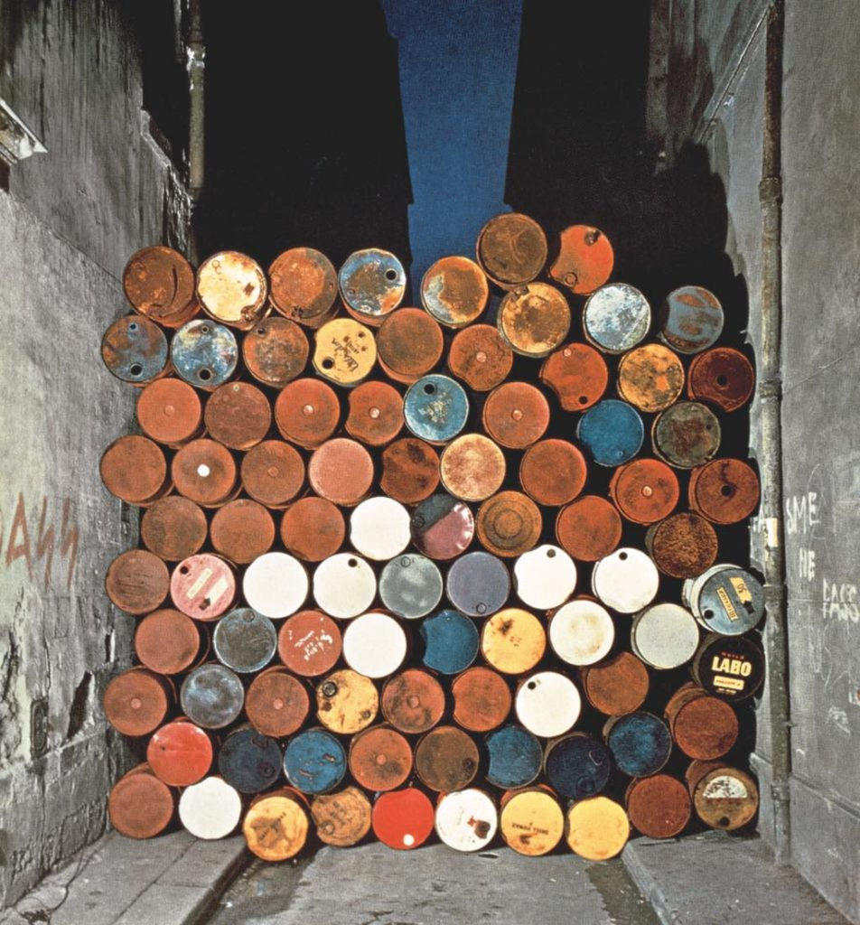 """Temporary Wall of Oil Barrels–The Iron Curtain"" (1962). © Christo 1962 Photo © Jean-Dominique Lajoux"