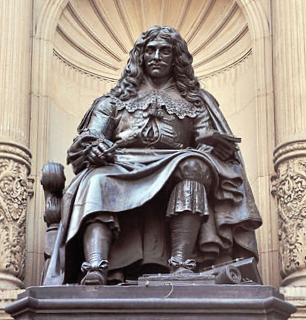 The bronze statue of Molière by Bernard-Gabriel Seurre on the fountain at the corner of Rue Richelieu and Rue Molière in Paris. Wikimedia Commons