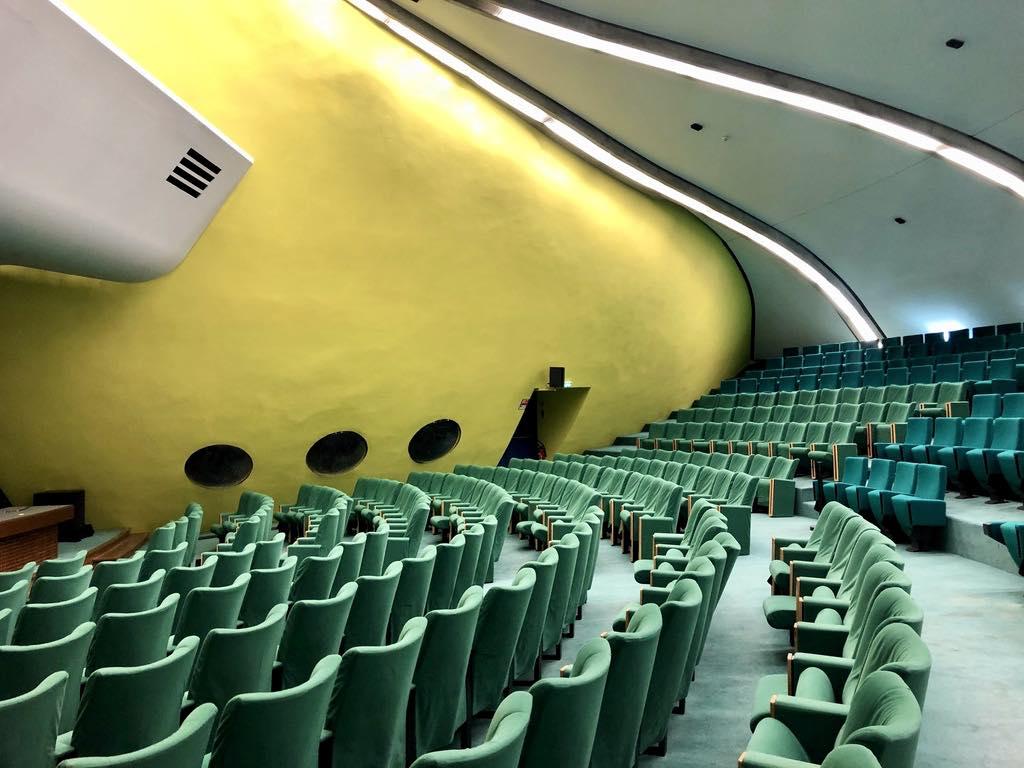 "The auditorium of Niemeyer's Bourse du Travail in Bobigny, a ""red suburb"" of Paris. © Paris Update"