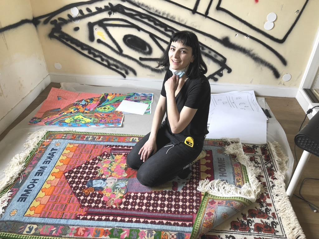 Araks Sahakyan in her studio with some of her carpets. © Paris Update