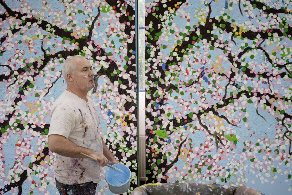 Damien Hirst in his studio, 2019. Photographed by Prudence Cuming Associates. Damien Hirst and Science Ltd. All rights reserved, DACS 2021